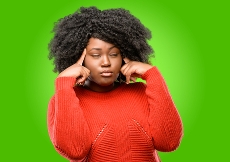 Beautiful african woman doubt expression, confuse and wonder concept, uncertain future Stock Photo