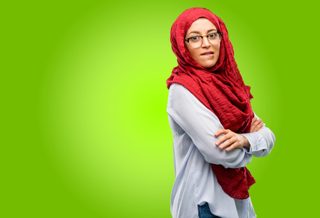 Young arab woman wearing hijab nervous and scared biting lips looking camera with impatient expression, pensive Stock Photo