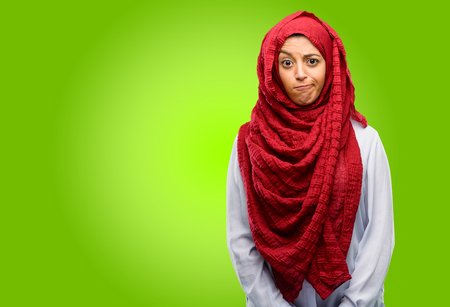 Young arab woman wearing hijab doubt expression, confuse and wonder concept, uncertain future