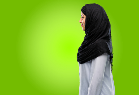 Young arab woman wearing hijab side view portrait