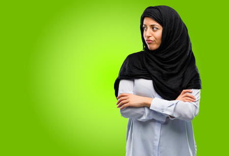 Young arab woman wearing hijab irritated and angry expressing negative emotion, annoyed with someone