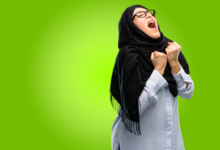 Young arab woman wearing hijab happy and excited celebrating victory expressing big success, power, energy and positive emotions. Celebrates new job joyful Banque d'images - 104070972