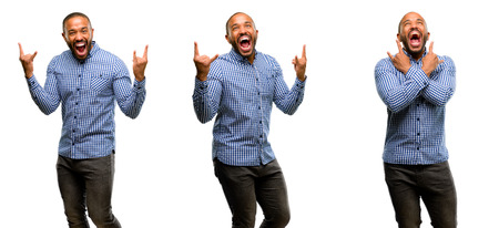 African american man with beard making rock symbol with hands, shouting and celebrating Stock Photo