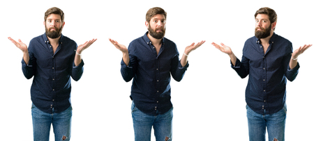 Young man with beard doubt expression, confuse and wonder concept, uncertain future isolated over white background Stock Photo