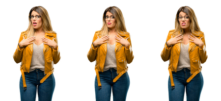 Beautiful young woman happy and surprised cheering expressing wow gesture over white background Stock Photo