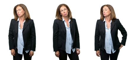 Middle age business woman having skeptical and dissatisfied look expressing Distrust, skepticism and doubt over white background Stock Photo