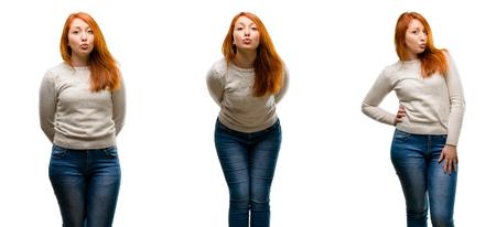 Young Beautiful redhead woman expressing love, blows kiss at camera, flirting Stock Photo