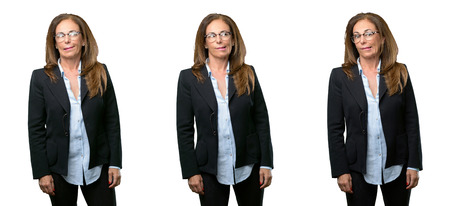 Middle age business woman doubt expression, confuse and wonder concept, uncertain future over white background