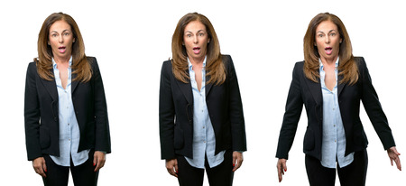 Middle age business woman scared in shock, expressing panic and fear over white background