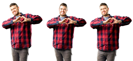 Young man happy showing love with hands in heart shape expressing healthy and marriage symbol isolated over white background, collage composition