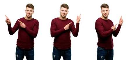 Handsome blond man pointing away side with fingers isolated over white background