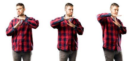 Young man serious making a time out gesture with hands isolated over white background, collage composition