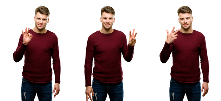 Handsome blond man raising his finger, is the number three isolated over white background