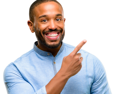 African american man with beard pointing away side with finger isolated over white background Фото со стока
