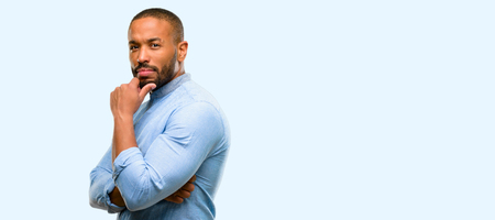African american man with beard with crossed arms confident and serious isolated over blue background