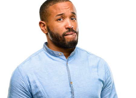 African american man with beard doubt expression, confuse and wonder concept, uncertain future isolated over white background Фото со стока