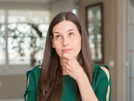 Young beautiful woman at home serious face thinking about question, very confused idea Stock Photo