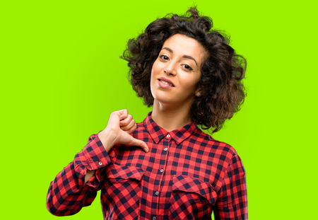 Beautiful arab woman proud, excited and arrogant, pointing with victory face Stock Photo
