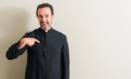 Senior priest religion man with surprise face pointing finger to himself