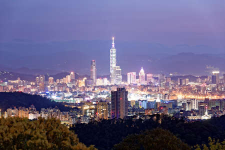City skyline in evening  twilight, Taipei Taiwan ~ Panoramic aerial view of crowded Taipei City, XinYi Commercial District, Keelung River and downtown area at moody dusk ~