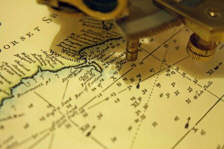 Old sextant on maritime chart Stock Photo