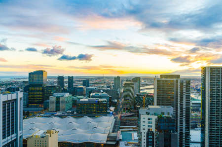 Melbourne city skyline overlooking docklands at sunset Stock Photo