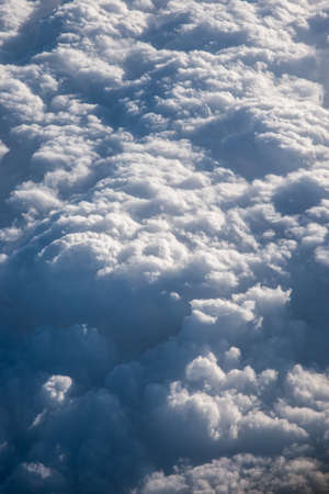 turbulent clouds building in the sky, shot from above