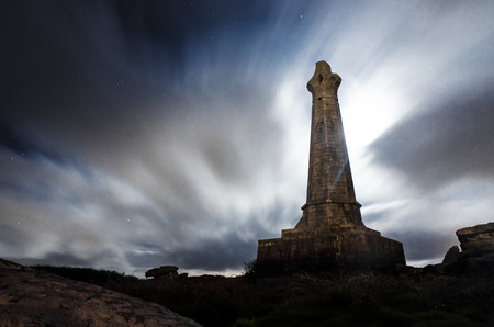 Carn Breas Basset monument under a cloudy night sky Editorial