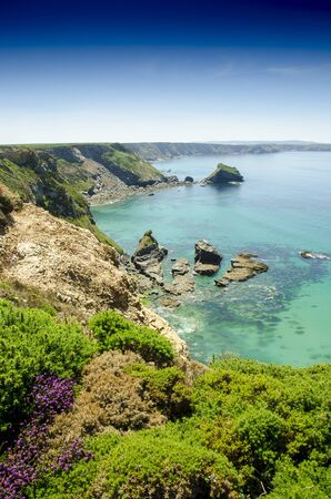 A beautiful sunny day at Bassets cove on top the cliff, Cornwall, England