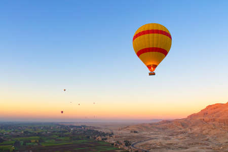 Hot air balloons at sunrise over the Nile in Egypt.