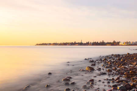 A warm sunset illuminates the shores of Dahab, a small town on the Red Sea coast of Egypt, Africa. Stock Photo