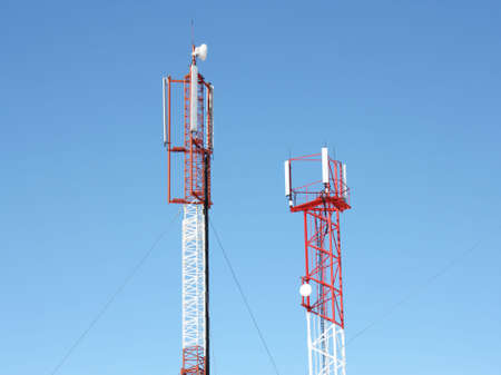 Mobile telecommunication technology antenna (radio antenne) for wireless mobile phone connections on blue sunny sky. Electrical wireless equipment concept Stock Photo - 7763301