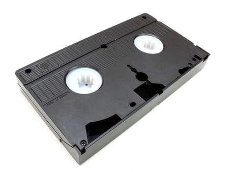 videocassette: The black old videocassette costs on a white background an underside upwards