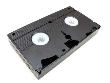 videocassette: Una parte inferior hacia arriba de fondo de los costos de cintas de v�deo antiguo negro sobre un fondo blanco  Foto de archivo