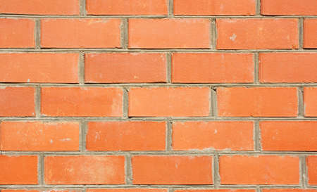 verticals: Red brick wall of the house, with lines of a laying of a solution Stock Photo