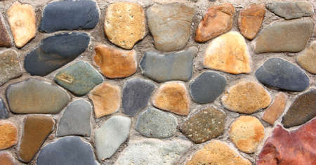 Stone wall of the house from different color of stones in a laying Stock Photo - 7987336
