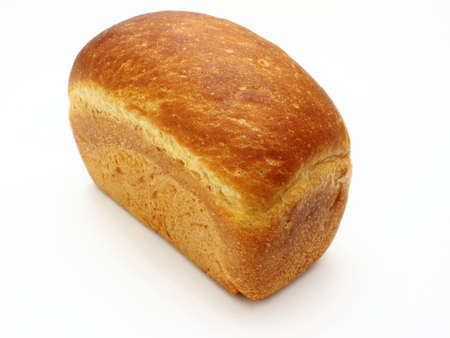 baguet: The ruddy long loaf of bread with the fried crust is isolated on a white background