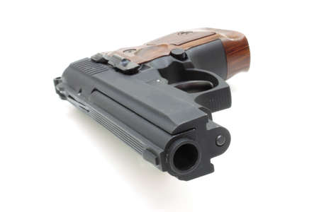 The close up of a pistol a target and cartridges is isolated on a white background Stock Photo - 7987138