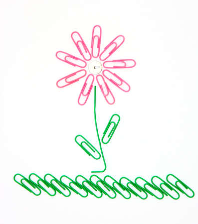 Beautiful flower on a grass from office paper clips for a paper photo