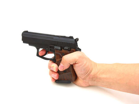 finger on trigger: Pistol in a hand separately on a white background
