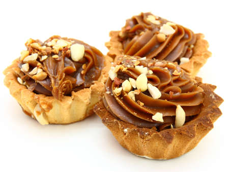 Pie a basket with chocolate condensed milk and nuts on a white background Stock Photo - 8385468
