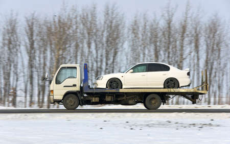 commercial vehicle: The wrecker carries the car of white color Stock Photo