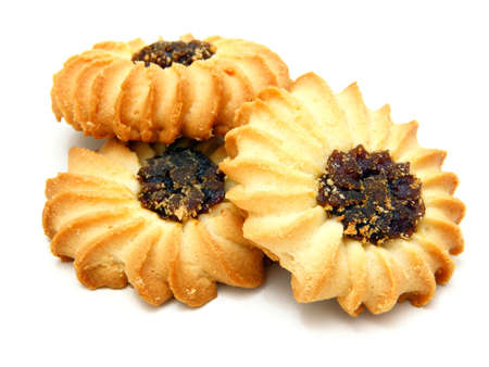 Tasty cookies with jam on a white background