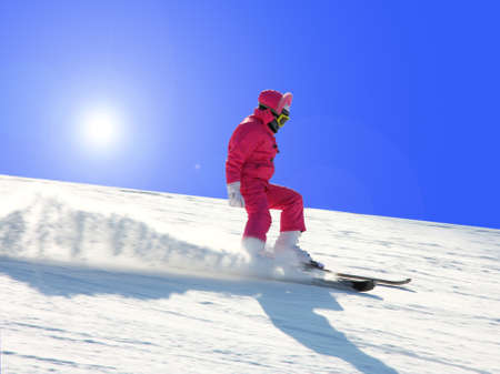 The young girl on skis goes from mountain in a spotty suit Stock Photo - 9033764
