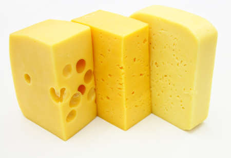 cheez: three pieces of different kinds of cheese isolated on a white background