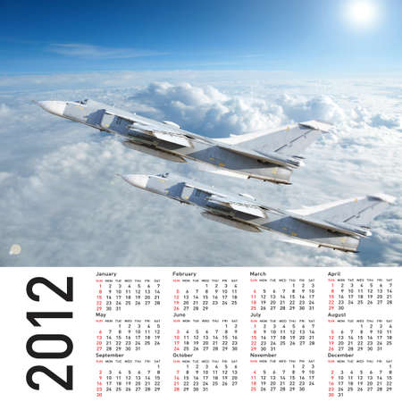 2012 Calendar with a military plane in the sky and clouds photo