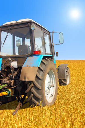 Tractor in a field, agricultural scene in summer Stock Photo - 11090100