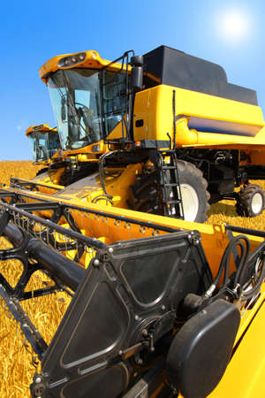 combine harvester on a wheat field with a blue sky Stock Photo - 11090090