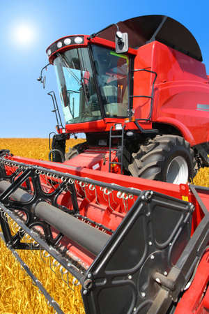 combine harvester on a wheat field with a blue sky Stock Photo - 11090057