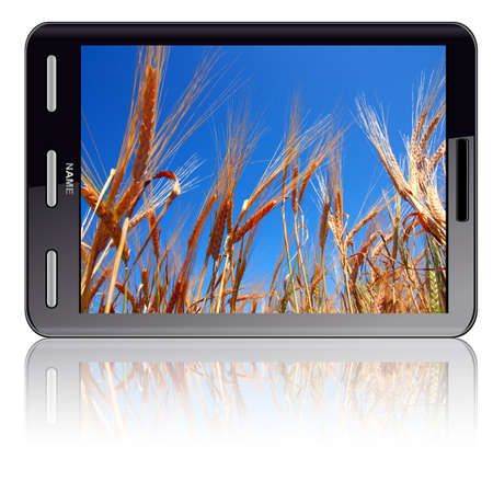 Vertical Tablet computer isolated on the white background. Screen saver and ears of wheat. Stock Photo - 11299103